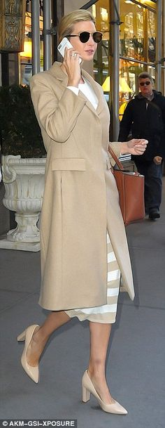 Matching: Ivanka had a white and beige striped ensemble underneath her winter coat...