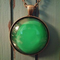 Check out this item in my Etsy shop https://www.etsy.com/listing/280868350/emerald-green-glass-pendant