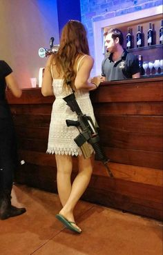 An off-duty Israeli soldier. They must have it w/them ALL the time. I bet no one dares bother this young woman. ;-)