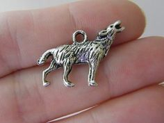 BULK 40 Howling wolf charms antique silver tone A286