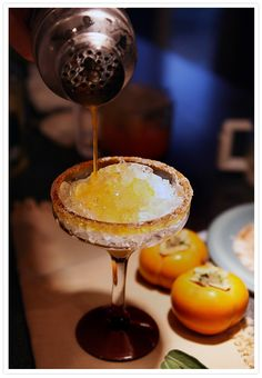 Persimmon Margarita  Ingredients  1 3/4 ounce tequila reposado  2–3 non-astringent persimmons, such as fuyu, peeled  1/2 ounce Agave Nectar or simple syrup (equal parts sugar and water, dissolved)  1 ounce lime juice, freshly-squeezed  Ice cubes    Cinnamon-sugar for glass rims