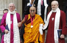 Sang Tan / APDalai Lama, Tibetan Buddhist spiritual leader, center, with Bishop of London Richard Chartres, right, and St.Paul's Cathedral Canon Pastor Reverend Michael Colclough as he leaves St. Paul's Cathedral in London after receiving the 2012 Templeton Prize awarded to him for encouraging scientific research and harmony among religions, on May 14.