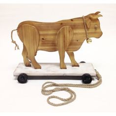 """Wilco Home Smokey Cabin """"Roller Skating Bull"""" Wood Pull Toy Statue Pull Toy, Cute Toys, Scroll Saw, Roller Skating, Wood Toys, Wood Construction, Statues, Black And Brown, Lion Sculpture"""