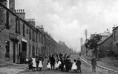 Old photograph of cottages houses and children in Gilmerton village by Edinburgh, Scotland
