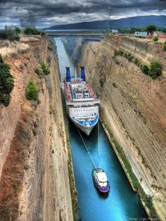 Corinth Canal in Greece. Rock walls that rise 90 m ft) at a near-vertical angle and a width of only m ft) at its base, when large ships pass through the km long Corinth Canal in Greece, it can look very dramatic! Places Around The World, The Places Youll Go, Places To See, Around The Worlds, Corinth Canal, Corinth Greece, Greece Travel, Greece Cruise, Greece Trip