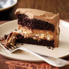 Crunchy Milk Chocolate-Peanut Butter Layer Cake | The genius of this layer cake is its extraordinarily crunchy filling, made with almonds, salted peanuts, creamy peanut butter, chocolate and Rice Krispies.