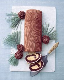 This buche de Noel, the French Yule log cake, is richly detailed with a wood-grain pattern. It's made by pressing a plastic mat into rolled fondant and then rubbing the imprint with cocoa powder. Inside, there's chocolate cake with caramel cream. Molded milk-chocolate pinecones and real pine needles coated in sugar (decorative only) make enchanting garnishes.Find fondant at sugarcraft.com.