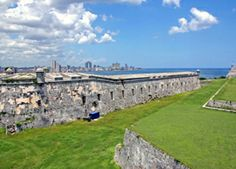 La Cabaña fortress is located on the east side of the Havana Bay near the harbor mouth. Center point of the Spanish colonies dominance was La Cabaña a mighty structure built to dissuade pirates. Imposing with its 18th century walls, it was built at the same time as El Morro.