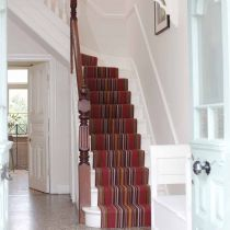 Steep stripy stairs! They're like little streams of colour descending down to the hall.