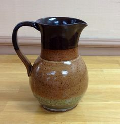 Brown stoneware clay pottery pitcher