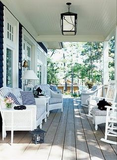I will have a big porch one day!!  Also like the mix of white wicker with the white rockers.  Cozy and inviting for a front porch.  The country cottage look is what I will be going for when we build!  Oh the next five years are going to go by slowly, so bare with me!!!  Outside lamp for late nights of waiting up on Macy and Trent, remember an outlet in this location of porch.  By the time we build the  house, yes I will have to think about waiting up on my children.
