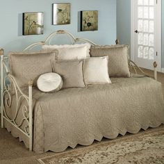 http://www.minimalisti.com/wp-content/uploads/2014/09/daybed-covers-daybed-bedding-sets-beige-white-color-blue-wall-color-brown-ornate-rug.jpg