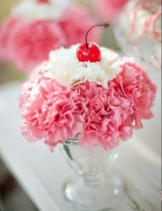 Carnation arrangement resembling an ice cream sundae! Cool way to develop children's interest/appreciation for plants/flowers. Take them to the 2nd hand & craft stores for sundae dishes & faux maraschino cherries, then go out to the garden or your grocery/floral store for the carnations!