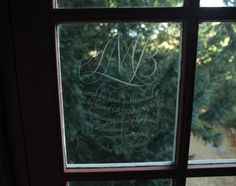 """An engraved birthday gift to Lucy Boston in the music room window. This room upstairs is the old hall, the nucleus of the original dwelling. During the war Lucy put its large gramophone to use, giving twice-weekly recitals to the RAF. Having lived """"in all the music capitals of Europe,"""" she knew her stuff and the collection of old 78 rpm records, which are still played, is impressive."""