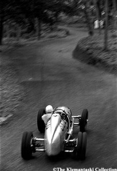 Louis Klemantaski - Prescott Hill-Climb_ May 14_ 1939 George Abecassis roars up into the Esses in his two-liter Alta. In this photo one can see the twisting road ahead and the slide of the car caught by the driver. Much is blurred by motion, but the steering wheel is in perfect focus.9 -