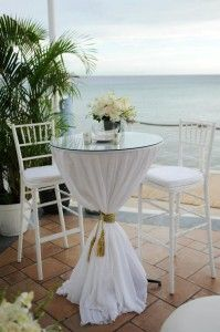 Bobbie and Rene' Wedding –  I like the glass and floral, chairs