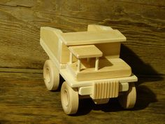 Handmade original design wood toy dump truck. 10 inches long and 6 inches wide, wheels all turn and comes with 1 little wood person for seat. Made from pine, spruce, maple (wheels), and glued together with non-toxic child safe glue. The truck has no oils, stains, or finishes applied to it and is paintable. The bottom is wood burned with my initials CHH and 15 (year made). If you have any questions feel free to ask, thanks for looking.