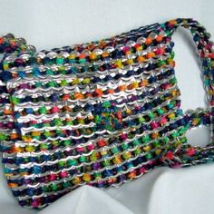 Make a purse out of can tabs with weaving. After drinking soda from aluminum cans, you can recycle your soda cans to create interesting projects instead of tossing the empty cans into the garbage or recycling bin. http://hative.com/creative-soda-can-crafts/