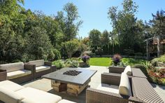 Bluestone patio with exquisite mosaic design and stone barbecue pit.