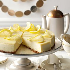 Lovely Lemon Cheesecake Recipe -Watch for the oohs and ahs when you present this luxurious cheesecake. The lemon flavor gives it a bright and tangy flair. —Margaret Allen, Abingdon, Virginia