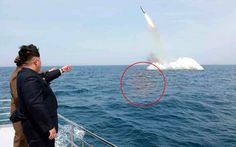 """North Korean leader praises test of submarine-launched missile as """"historic   event"""" - despite experts claiming launch was manipulated by state media"""