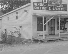"""""""Coke, Coffins & Caskets"""" The L. Kitts general store in Maynardville, Tennessee, 'bout a coffin or a casket to go with that Coke?that is a REAL general store. Old General Stores, Old Country Stores, Vintage Pictures, Old Pictures, Old Photos, Coca Cola, Ben Shahn, Old Buildings, Casket"""
