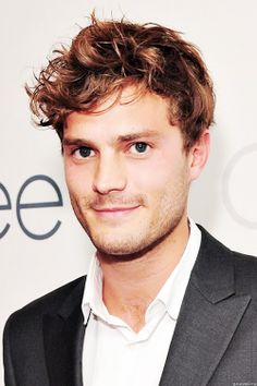 Jamie Dornan looking ever like the young carefree Christian Grey with sexy unruly hair.