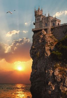 The Swallow's Nest is a decorative castle located between Yalta and Alupka on the Crimean peninsula in southern Ukraine. It was built between 1911 and 1912 in Gaspra, on top of 40-metre (130 ft) high Aurora Cliff.