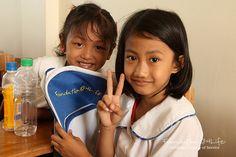 Students enjoying their new     Foundation 4Life® backpacks.