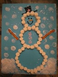trace snowman on construction paper. Kids glue marshmallows on the traced line. Kids use marshmallows to stamp snowflakes. Pretzel arms.