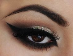 Soft look for brown eyes with cat-eye liner and a bit of glitter.