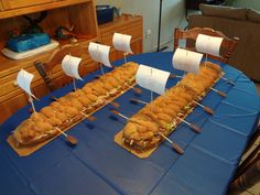 Instead of sandwich, could be a cool idea for the cake? A sheet cake cut in half lengthwise with oars and flags?