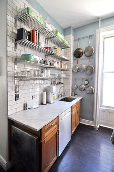 This is our future kitchen: wood cabinets, marble counters, subway tile with gray grout, dark wood floors, lots of light