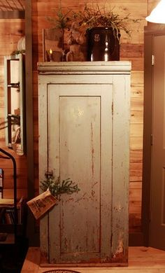Pantry.  I have one that is similar.  Not as old. Mine needs to be painted.  I like this color.