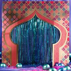 Our Arabian Nights Photo Background makes a fabulous addition to your event. This freestanding cardboard prop is printed with a colorful tile design and accented with an aqua foil fringe curtain. Aladdin Arabian Nights, Arabian Nights Prom, Arabian Party, Arabian Nights Theme, Arabian Theme, Photo Booth Background, Night Background, Halloween Frames, Spooky Halloween