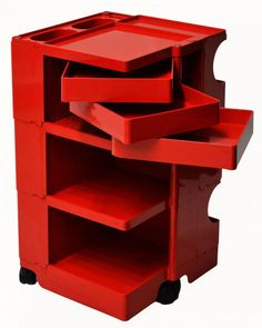 Italian mid-century portable storage cart, late 1960Æs, signed at lower shelf Joe Columbo (Joe Cesare Colombo, Italian Industrial Designer, 1930-1971), red plastic with swing out trays, shelves, and bins