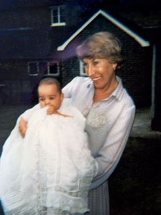 Kate as a baby in her Christening gown, with her grandmother.