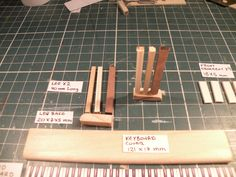 Miniature Piano workshop. Step no. 3  Paste the parts of the piani legs as shown on the picture.