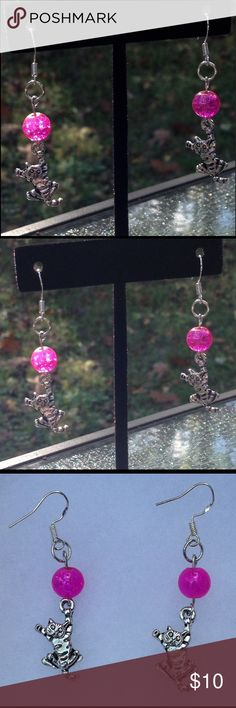 Pink Cat Sterling Silver Earrings These adorable earrings are made with sparkling pink glass beads. They feature silver tone kitty cat charms and sterling silver hooks.   All PeaceFrog jewelry items are handmade by me! Take a look through my boutique for coordinating jewelry and more unique creations! PeaceFrog Jewelry Earrings