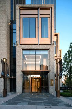 PVD stainless steel in Rose Gold Vibration is used for door reveals and window surrounds at the Shanghai Bund Financial Centre. Heatherwick Studio - PVD: John Desmond Ltd Steel Building Homes, Metal Building Kits, Building A House, Building Ideas, Steel Buildings, Modern Buildings, Modern Architecture, Shanghai Bund, Modern Entrance Door