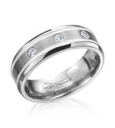 Hearts On Fire - Commanding Titanium Commanding Milgrain Band. I like this for Billy.