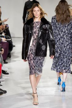 """For one, there was the way he layered and peeled back knit sleeves on floral dresses with clear top layers. Or the punchy bright mix of pink, purple, green, yellow and blue — reminiscent of his days at Jil Sander. He made free with American tropes:cowboy boots peeked out from under double breasted suits or longer pencil skirts and feminine cinch-waisted flared skirts were paired with """"cute"""" tops that sported some seriousunder-boob (a perky problem that CK Underwear should no doubt so"""