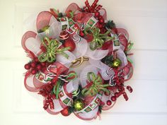 Red,Green,and White Deco Mesh Christmas Wreath Can be found on www. Etsy.com