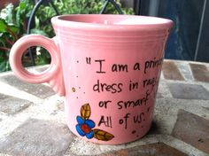 "Fiesta® 'A Little Princess' Hand-painted Literary Quote Mug by OpheliasGypsyCaravan on Etsy. The Flamingo Fiesta® Mugs features the quote ""I am a princess. All girls are... even if they dress in rags, even if they aren't pretty, or smart, or young. They're still princesses. All of us.""  ~ Frances Hodgson Burnett surrounded by two small hand-painted flowers 