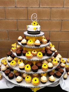 Summer Wedding - Cake was covered in fondant and painted decoration with fondant sunflowers.  Cup cakes are buttercream with fondant sunflowers