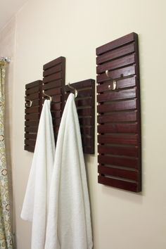 I used the shelves from a thrift store stand to make these great bath hooks for towels.