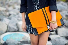 Tangerine clutch. Love the pop of color!