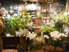 Flower Shop, NY--I've always had this silly dream of having a small apartment above a bookstore or flower shop. In France, though.
