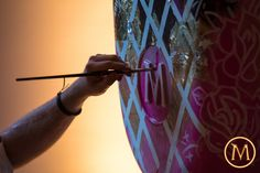 painting a large magnum during the opening of the magnum pleasure store opening amsterdam