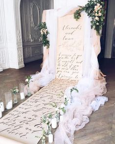 Beautiful scroll style ceremony backdrop.